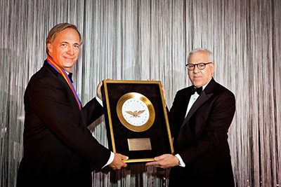 "PAY IT FORWARD: Ray Dalio receives the Golden Plate Award of the Academy of Achievement. Along with Bill Gates and Warren Buffet, Ray Dalio has signed ""The Giving Pledge,"" committing to giving half of his net wealth to charity over the course of his lifetime. He has created The Ray Dalio Foundation to channel his philanthropic contributions. Read more about Dalio's charitable giving."